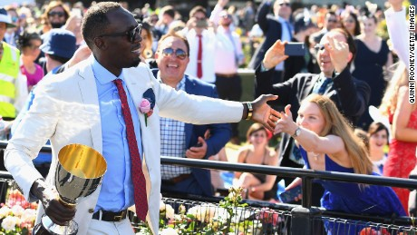 Usain Bolt presented trophy on Oaks Day at Flemington in 2016