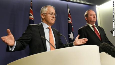 Australia's Prime Minister Malcolm Turnbull (L) and Deputy Prime Minister Barnaby Joyce (R) address the media during a press conference in Sydney on July 5, 2016.