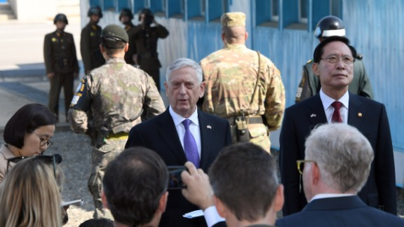 US Secretary of Defence Jim Mattis (C) speaks to the media as South Korean Defence Minister Song Young-Moo (R) looks on during a visit to the truce village of Panmunjom in the Demilitarized Zone (DMZ)  on October 27, 2017.