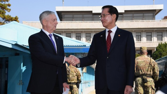 US Secretary of Defence Jim Mattis (L) shakes hands with South Korean Defence Minister Song Young-Moo (R) as they visit the truce village of Panmunjom in the Demilitarized Zone (DMZ) on the border between North and South Korea on October 27, 2017.