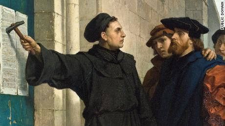 Martin Luther posting his 95 theses on the church door, created in 1871.