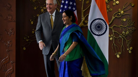 Indian Foreign Minister Sushma Swaraj (R) and US Secretary of State Rex Tillerson walk together before a meeting in New Delhi on October 25, 2017. US Secretary of State Rex Tillerson on October 25 started talks with Indian leaders expected to highlight the strong alliance between the two nations, with both anxious to counter China