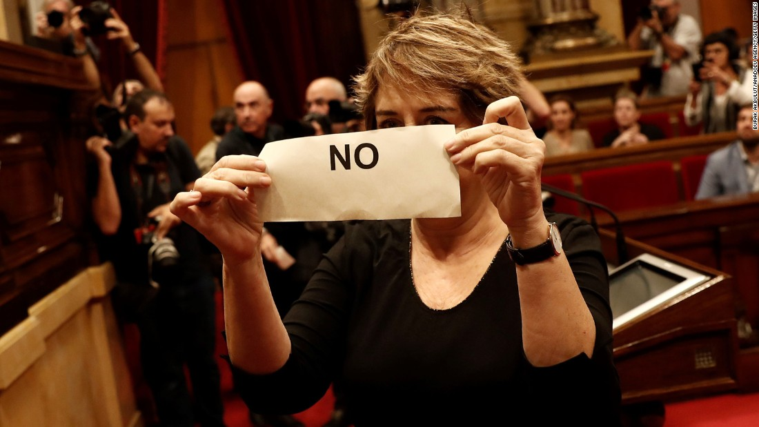 "A deputy of Catalonian Parliament, who is oppose to independence of Catalonia holds a ""No"" ballot during the independence voting at Catalonian Parliament in Barcelona, Spain."
