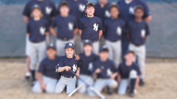 Dustin (bottom row, second from left) and Joseph (top row, center) played Little League together.