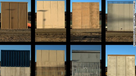 This combination of pictures shows the eight prototypes of US President Donald Trump's US-Mexico border wall being built near San Diego, in the US, seen from across the border from Tijuana, Mexico, on October 22, 2017.  GUILLERMO ARIAS/AFP/Getty Images