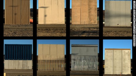 This combination of pictures shows the eight prototypes of US President Donald Trump's US-Mexico border wall being built near San Diego, in the US, seen from across the border from Tijuana, Mexico, on October 22, 2017.  Following up on President Donald Trump's campaign promise to build a wall along the entire 3,200 kilometre (2,000 mile) Mexican frontier, the Department of Homeland Security began building prototypes for the barrier along the border in San Diego and Imperial counties, as it announced in August. / AFP PHOTO / GUILLERMO ARIAS        (Photo credit should read GUILLERMO ARIAS/AFP/Getty Images)