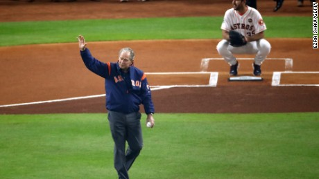 Former President George W. Bush throws out the ceremonial first pitch to Justin Verlander of the Houston Astros before Game 5 of the 2017 World Series at Minute Maid Park on October 29, 2017, in Houston.