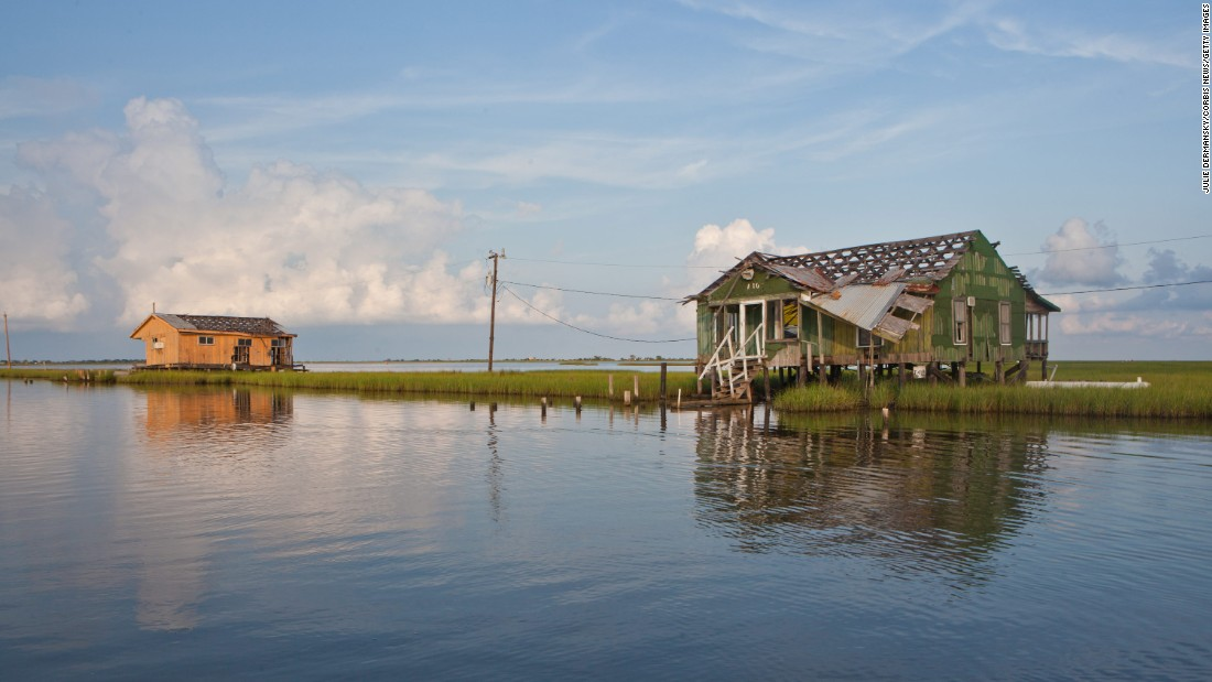 "Located 80 miles from New Orleans, this isle has been <a href=""http://edition.cnn.com/2017/03/02/us/heart-of-the-matter-climate-change-louisiana/index.html"">sinking slowly.</a> Since 1955, it has lost 98% of its land mass to rising sea levels,  hurricanes, and the construction of oil and gas canals along the marsh. The US Department of Housing and Urban Development awarded $48 million to the state of Louisiana in 2016 to relocate the community to higher ground off the island."