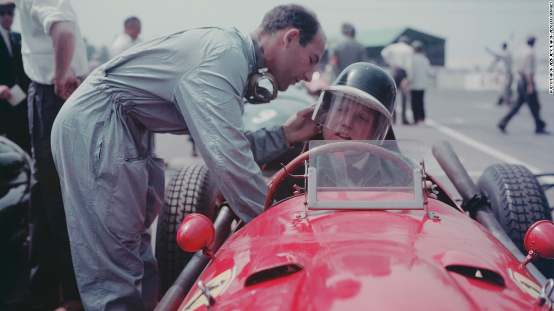 British racing driver Stirling Moss (left) adjusts Hawthorn's helmet before a race. The documentary contains many gruesome moments, but also many previously unseen clips of drivers off the track -- in the pit lane, horsing about and on the road as they made their way from one race to the next. <br />