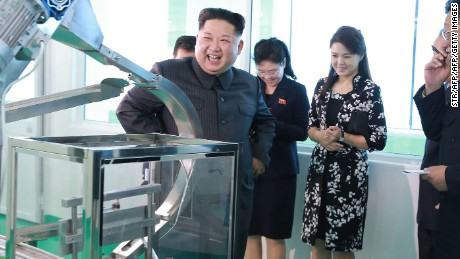 Undated KCNA photo released on October 29, 2017 shows North Korean leader Kim Jong Un inspecting the Pyongyang Cosmetics Factory with his wife Ri Sol Ju (2nd right).