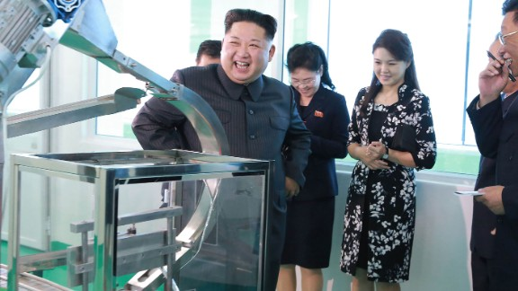 A photo released by North Korean state media in October 2017 shows Kim and Ri touring a cosmetics factory.