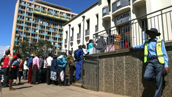 Zimbabweans queue to withdraw cash outside a bank in Harare. A severe currency shortage has led to growing interest in digital alternatives.