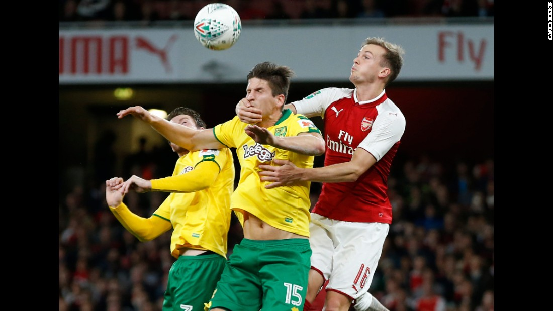 Arsenal's Rob Holding grabs the face of Norwich City's Timm Klose during a League Cup soccer match in London on Tuesday, October 24. Arsenal advanced to the quarterfinals with a 2-1 victory.