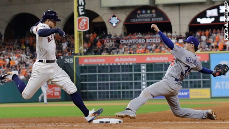 Houston Astros' George Springer beats Los Angeles Dodgers' Cody Bellinger to first base during the sixth inning of Game 3 of baseball's World Series Friday, Oct. 27, 2017, in Houston. (AP Photo/David J. Phillip)