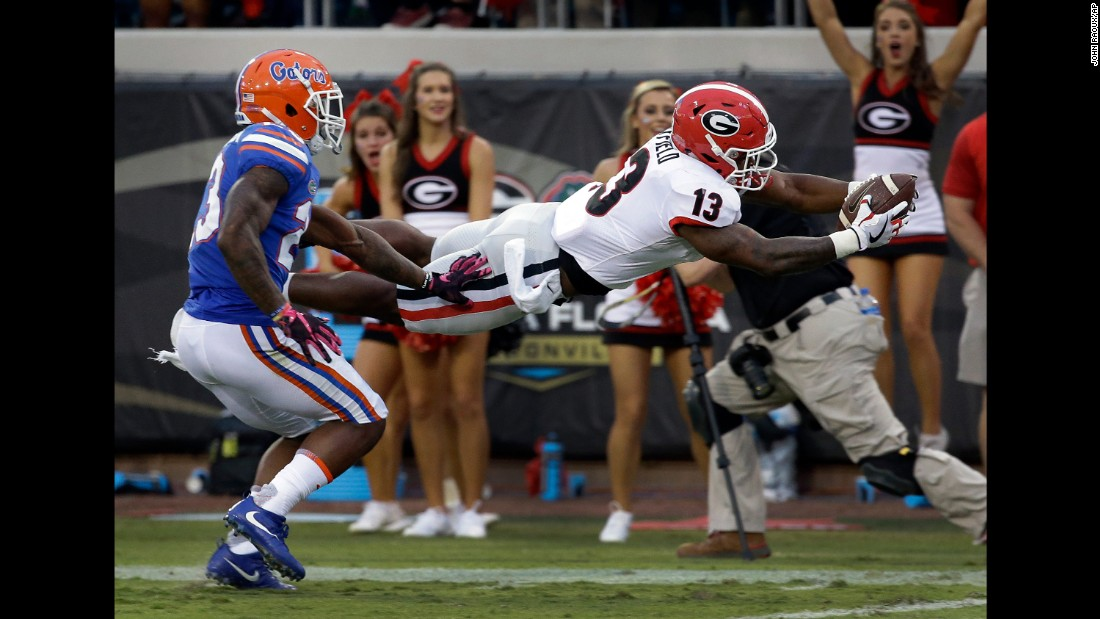 Georgia running back Elijah Holyfield dives over the goal line during the Bulldogs' 42-7 victory over Florida on Saturday, October 28. Holyfield is the son of former heavyweight boxing champion Evander Holyfield.