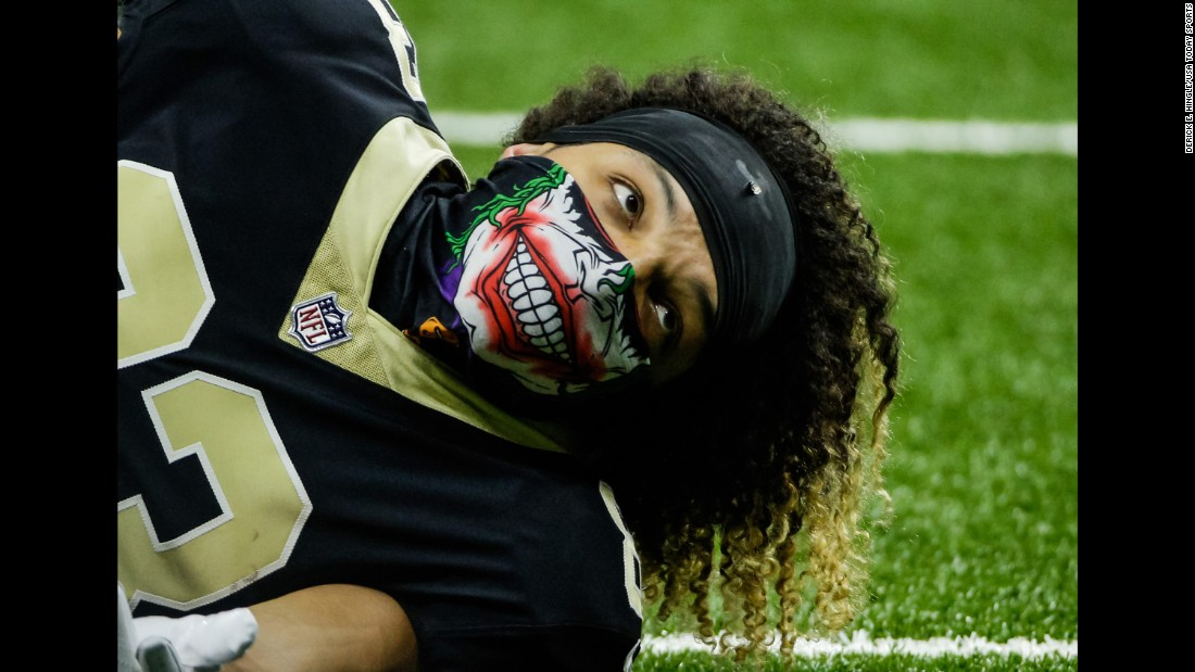 New Orleans wide receiver Willie Snead wears a Joker mask before an NFL game against Chicago on Sunday, October 29.