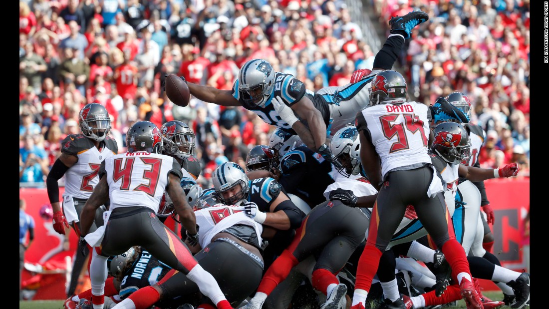 Carolina running back Jonathan Stewart leaps over the pile, scoring a touchdown during an NFL game in Tampa, Florida, on Sunday, October 29. Stewart and the Panthers defeated the Tampa Bay Buccaneers 17-3.