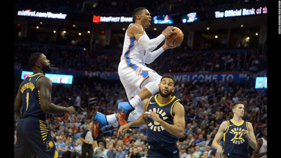 Oklahoma City guard Russell Westbrook rises above Indiana guard Cory Joseph during an NBA game in Oklahoma City on Wednesday, October 25.