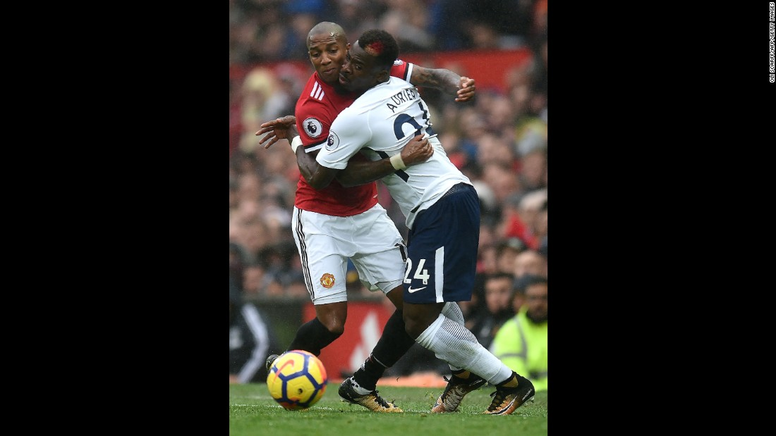 Manchester United's Ashley Young, left, collides with Tottenham's Serge Aurier during a Premier League match in Manchester, England, on Saturday, October 28.