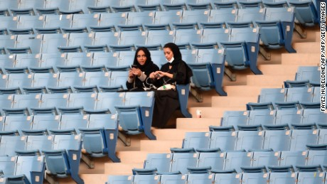 Saudi women sit in a stadium for the first time to attend an event in the capital Riyadh on September 23, 2017 commemorating the anniversary of the founding of the kingdom. The presence of women at the King Fahd stadium marks a departure from previous celebrations in the Gulf kingdom where they are effectively barred from sports arenas by strict rules on public segregation of the sexes. / AFP PHOTO / Fayez Nureldine        (Photo credit should read FAYEZ NURELDINE/AFP/Getty Images)