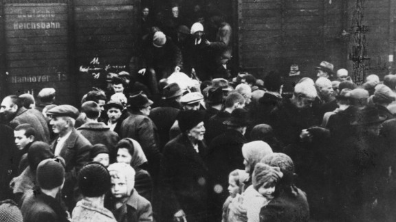 Jews deported from Hungary exit a German boxcar onto a crowded railway platform at  Auschwitz concentration camp, Poland, in May 1944.