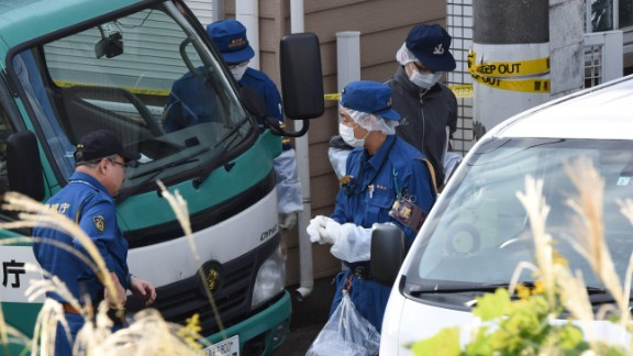 Policemen gather in front of an apartment where Japanese police found nine bodies, including two with their heads severed and dumped in a cool box in Zama, Kanagawa prefecture, on October 31, 2017. The bodies were of eight women and one man, several media reported.  / AFP PHOTO / Toru YAMANAKA        (Photo credit should read TORU YAMANAKA/AFP/Getty Images)