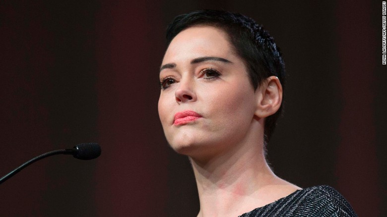US actress Rose McGowan gives opening remarks to the audience at the Women's March / Women's Convention in Detroit, Michigan, on October 27, 2017. 