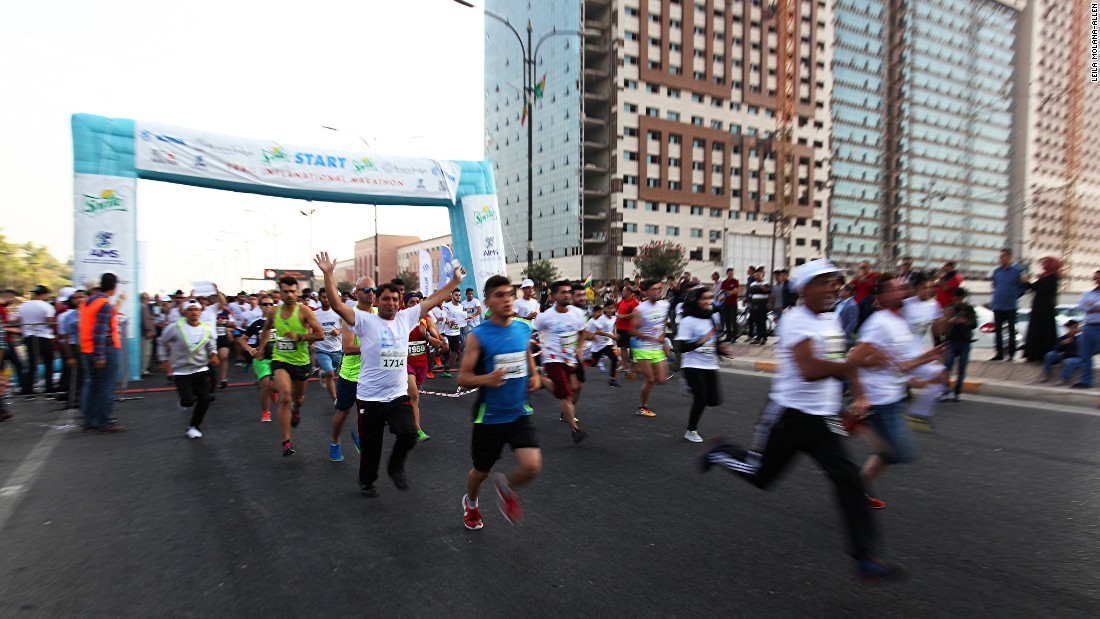 Despite the disruption, 2,000 people still participated. Here, runners stream onto the course after the starting buzzer.