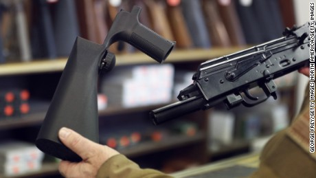 A bump stock device, seen here at left, fits on a semi-automatic rifle to increase its firing speed.