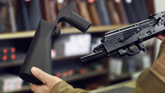 A bump stock, left, fits on a semi-automatic rifle to increase firing speed.