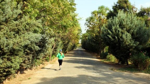 A woman runs through Erbil