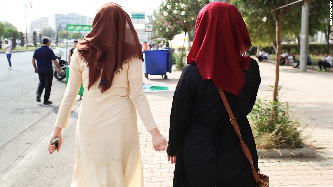 Two local female participants wearing the hijab run hand in hand at the race.