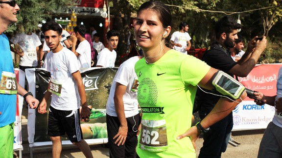 A German runner who reached Erbil for the race catches her breath at the end of the course.