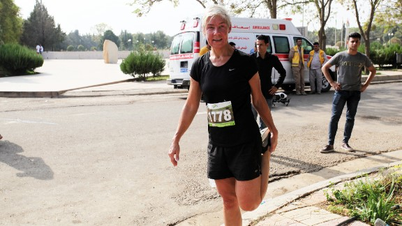 An expat runner stretches at the end of the marathon. After the race, there was a winners