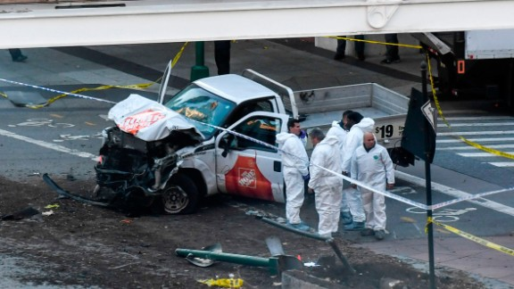 Investigators inspect a truck following a shooting incident in New York on October 31, 2017.  Several people were killed and numerous others injured in New York on Tuesday when a suspect plowed a vehicle into a bike and pedestrian path in Lower Manhattan, and struck another vehicle on Halloween, police said. A suspect exited the vehicle holding up fake guns, before being shot by police and taken into custody, officers said. The motive was not immediately apparent.   / AFP PHOTO / Don EMMERT        (Photo credit should read DON EMMERT/AFP/Getty Images)