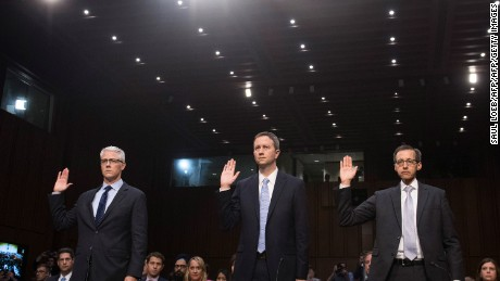 Colin Stretch (L), General Counsel of Facebook, Sean Edgett (C), Acting General Counsel of Twitter, and Richard Salgado (R), Director of Law Enforcement And Information Security of Google, are sworn in prior to testifying during a US Senate Judiciary Subcommittee on Crime and Terrorism hearing on Russian influence on social networks on Capitol Hill in Washington, DC, October 31, 2017. / AFP PHOTO / SAUL LOEB        (Photo credit should read SAUL LOEB/AFP/Getty Images)