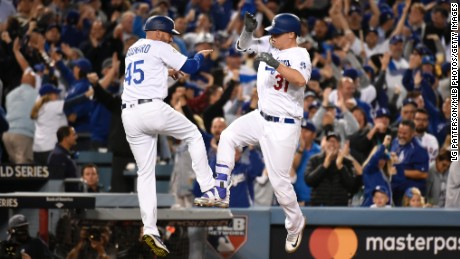 Joc Pederson (31) of the Los Angeles Dodgers celebrates with third base coach Chris Woodward (45) after hitting a solo home run in the seventh inning during Game 6 of the 2017 World Series against the Houston Astros at Dodger Stadium on Tuesday, October 31, 2017 in Los Angeles, California.