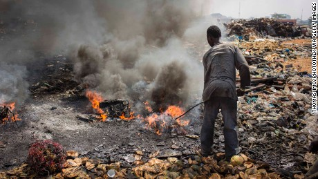 A man burns electronic waste on the biggest electronic scrap yard of Africa in Agbogbloshie, a district of the Ghanaian capital.