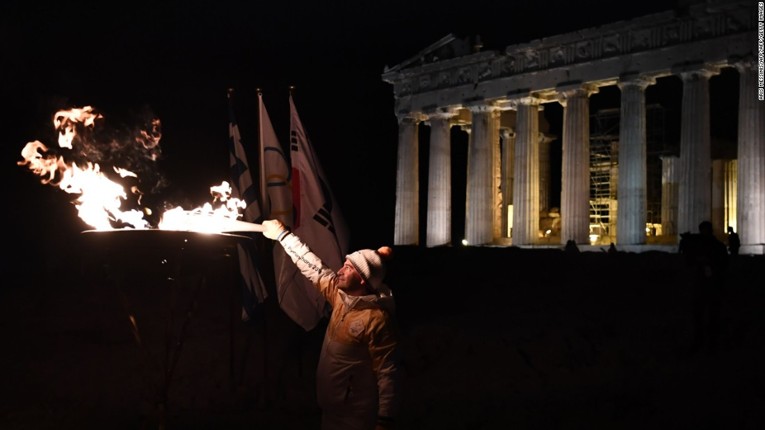 A succession of torchbearers carried the flame to the top of Acropolis Hill, where Greek gymnast Dimosthenis Tampakos (Olympic champion in the rings at Athens 2004) illuminated the columns of the Parthenon.