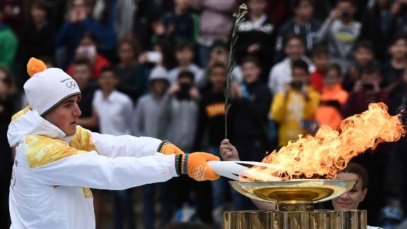 After completing a week-long tour of Greece, the flame was officially passed to the PyeongChang organizing committee at a handover ceremony. Greek Alpine skier Ioannis Proios is shown holding the torch at the ceremony in Athens