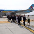 south korea olympic flame arrives plane incheon airport