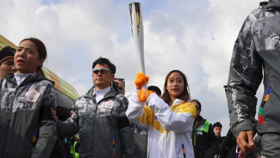 The honor of being the first to carry the Olympic flame on home soil fell to 13-year-old figure skating prodigy You Young.