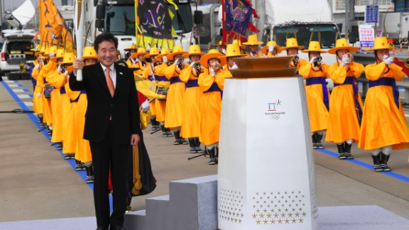 The Prime Minister of the Republic of Korea, Lee Nak-yon, then lit the cauldron to signal the start of the Olympic flame