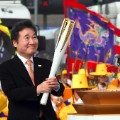 South Korean Prime Minister Lee Nak-Yon lights the Olympic torch incheon bridge pyeongchang winter games