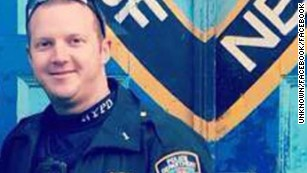 Who is the NYPD officer who apprehended the suspect?