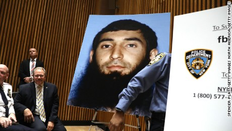 NEW YORK, NY - NOVEMBER 01:  A picture of suspect Sayfullo Saipov is displayed during a news conference about yesterday's attack along a bike path in lower Manhattan that is being called a terrorist incident  on November 1, 2017 in New York City.  Eight people were killed and 12 were injured on Tuesday afternoon when suspect 29-year-old Sayfullo Saipov intentionally drove a truck onto a bike path in lower Manhattan.  (Photo by Spencer Platt/Getty Images)