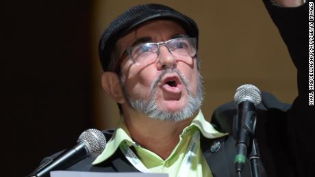 "FARC leader Rodrigo Londono Echeverri, known as ""Timochenko"" speaks during the opening of their National Congress in Bogota on August 27, 2017 Colombia's leftist FARC rebels sought political rebirth on Sunday as they launched steps to transform into a party and seek elected office after disarming to end a half-century war. / AFP PHOTO / Raul Arboleda        (Photo credit should read RAUL ARBOLEDA/AFP/Getty Images)"