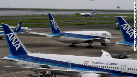 All Nippon Airways (ANA) jetliners are seen on the tarmac and taxiway at Haneda international airport in Tokyo on August 2, 2017. Japan's All Nippon Airways is expected to release its April-June earnings results on August 2.  / AFP PHOTO / Toshifumi KITAMURA        (Photo credit should read TOSHIFUMI KITAMURA/AFP/Getty Images)