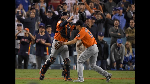 Astros catcher Brian McCann hugs pitcher Charlie Morton after the final out. Morton got the win, pitching the last four innings of the game.