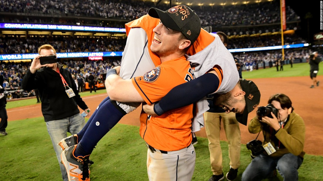 Bregman carries second baseman Jose Altuve during the postgame celebrations.